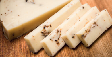 Yellow cheese with black truffle